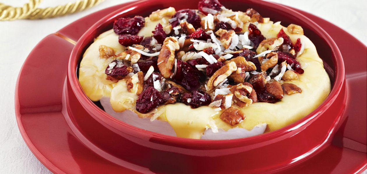Warm Brie Topped with Dried Fruit, Pecans & Coconut